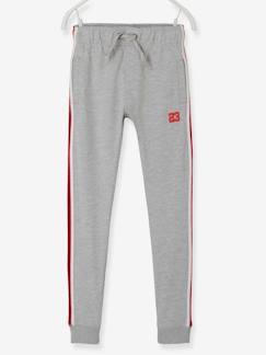 ee3af100e8f Pantalón de deporte niño con franjas laterales a rayas